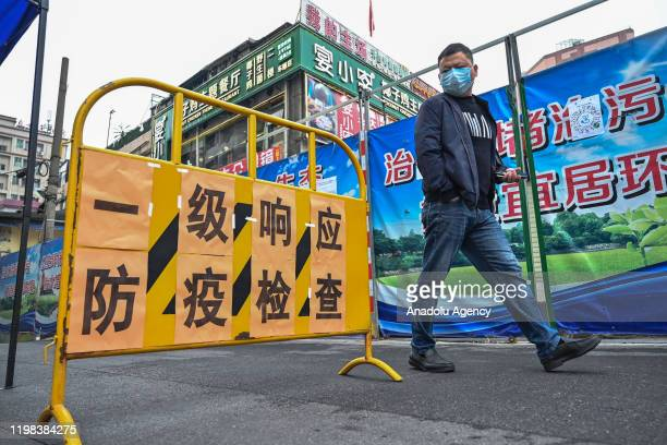 Security set obstacles to monitor people's body temperature on February 3,2020 in Guangzhou,China.In order to effectively control the epidemic, the...