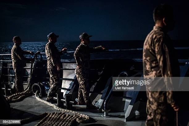 Security ship crews of Ministry of Maritime Affairs and Fisheries, stand on the main deck during a patrol in the South China Sea on August 17, 2016...