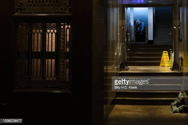 A security sits at the guard kiosk during a coronavirus outbreak on March 26 2020 in Hong Kong China Latest statistics showed Hong Kong tourist...