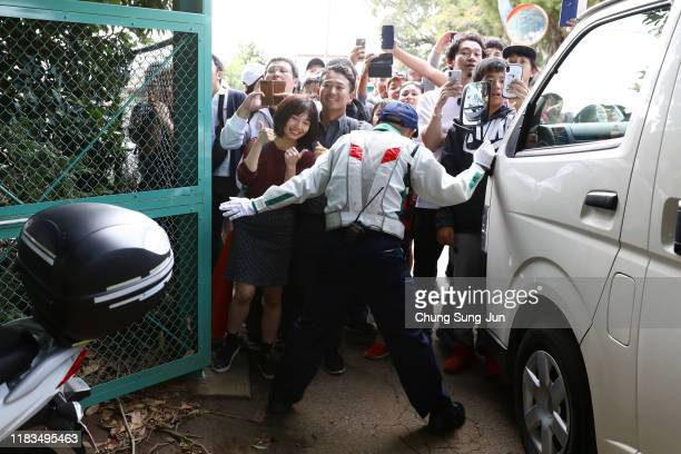 A security staff blocks fans as no spectators are allowed to enter the course during the second round of the Zozo Championship at Accordia Golf...