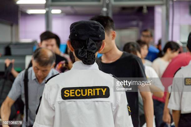 Security staff checking commuters at the Guangzhou metro
