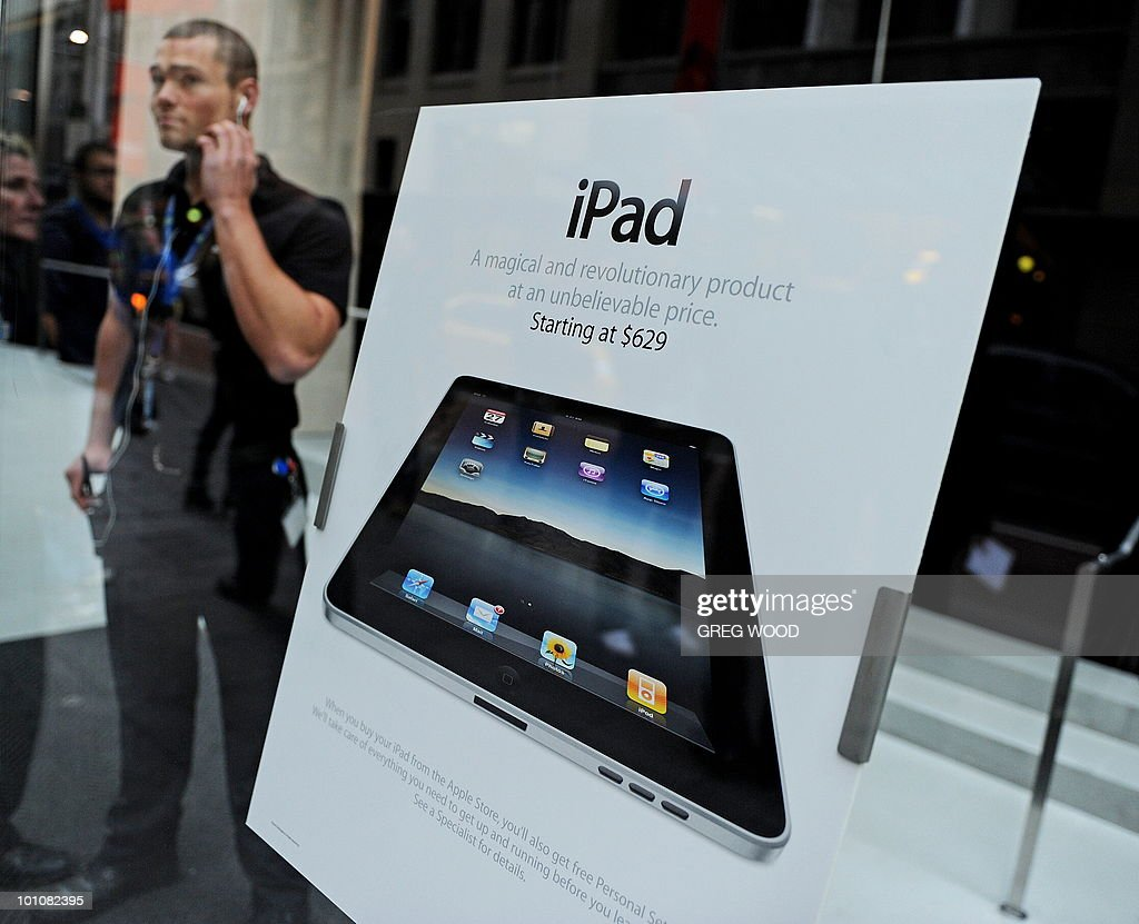 A security staff member (L) stands alongside signage at the entrance to Apple's flagship store in Sydney on May 28, 2010 just prior to the much-hyped iPad going on sale. The iPad -- a buttonless tablet computer targeted at the leisure market -- is also going on sale in Japan, Britain, Canada, France, Germany, Italy, Japan, Spain and Switzerland on May 28 as part of a staggered global roll-out. AFP PHOTO / Greg WOOD