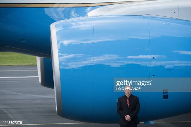 A security staff member stands in front of the Air Force One transporting US President Donald Trump and US First Lady Melania Trump after it landed...