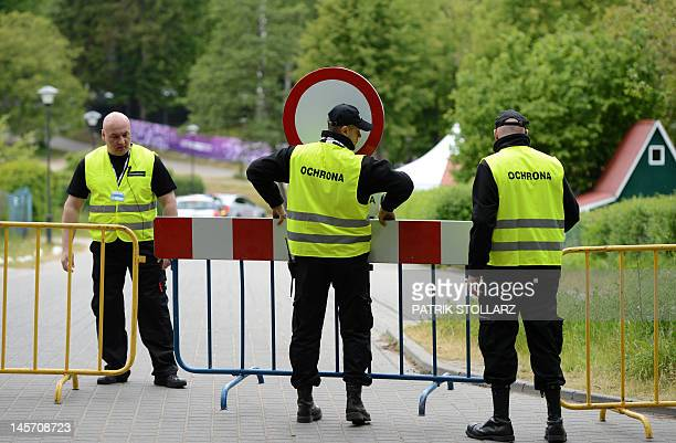 Security staff members move barriers near the Dwor Oliwski Hotel after the arrival of Germany's national football team for the Euro 2012 football...