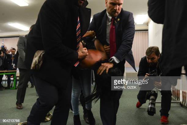 Security staff of Czech President Milos Zeman detain a woman being member of the Femen organisation after she attacked the President on January 12...