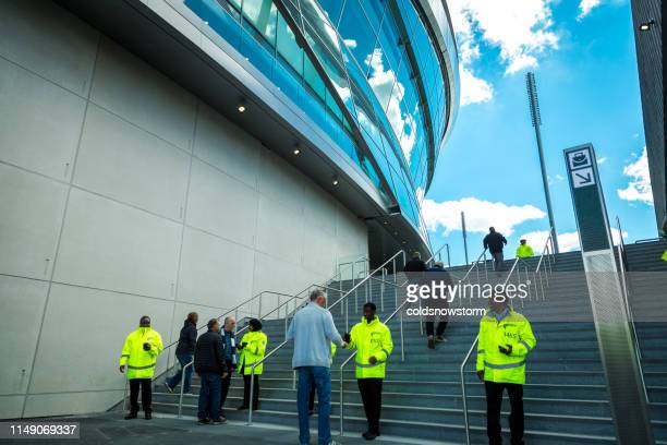 security staff outside new tottenham hotspur stadium on match day, london, uk - sports event stock pictures, royalty-free photos & images