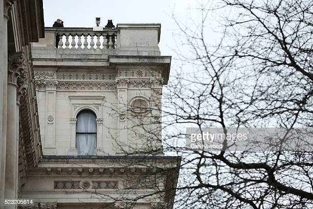 Security staff patrol from a roof ahead of the arrival of President Barack Obama at Downing Street to meet with British Prime Minister David Cameron...