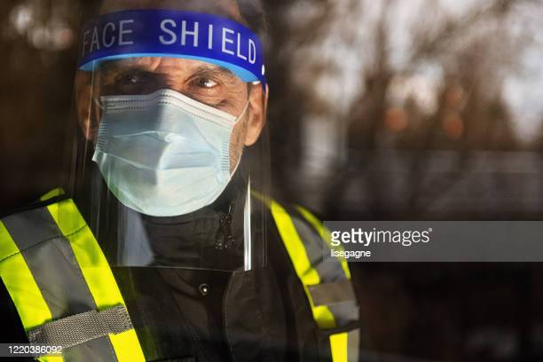security staff photographed through window - essential workers stock pictures, royalty-free photos & images