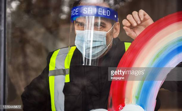 security staff photographed through window - helmet visor stock pictures, royalty-free photos & images