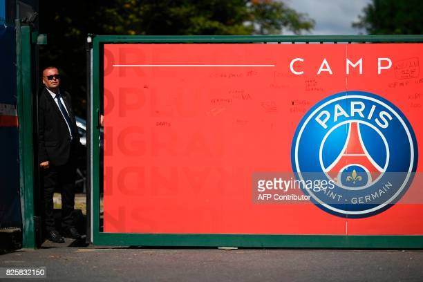 TOPSHOT A security staff stands at the entrance of the Paris SaintGermain's Camp des Loges training centre in SaintGermainenLaye western Paris on...