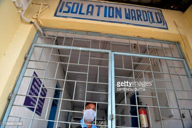 A security staff wearing a facemask stands at the emergency entrance of an isolation ward opened as a preventative measure following a SARSlike virus...