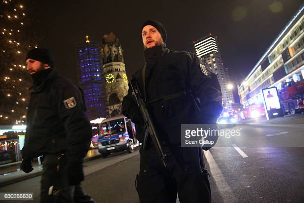 Security stand and guard the area after a lorry truck ploughed through a Christmas market on December 19 2016 in Berlin Germany Several people have...