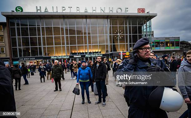 Security stand guard as supporters of Pro NRW a rightwing populist group that has campaigned against the construction of new mosques in the German...