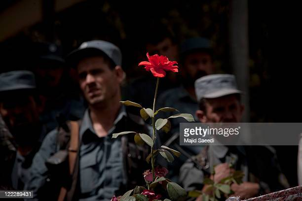 Security stand guard at a ceremony as a group of more than 100 members of the Taliban surrender themselves to the Afghan Government on August 26 2011...