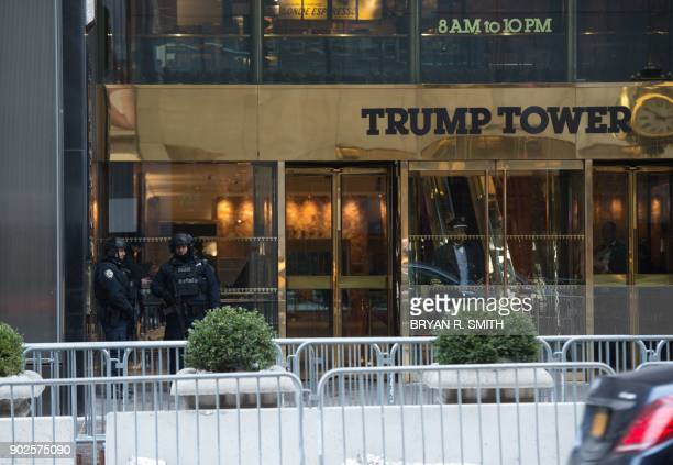 Security stand outside The Trump Tower on Fifth Avenue on January 8 2018 in New York A fire in the Trump Tower ventilation system in New York City...