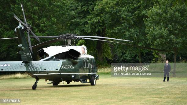 Security stands by Marine One as they prepare for the departure of US President Donald Trump and US First Lady Melania Trump at the US ambassador's...