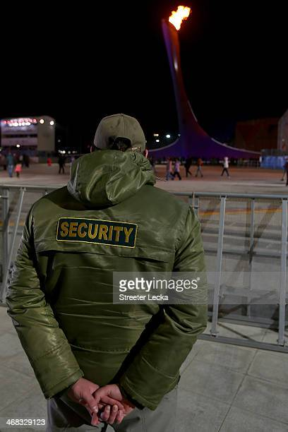 Security stands guard near the Olympic flame during day 3 of the Sochi 2014 Winter Olympics on February 10 2014 in Sochi Russia