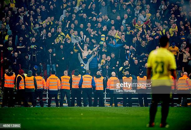 Security stands in front of the Brondby fans during the Danish Superliga match between FC Copenhagen and Brondby IF at Telia Parken Stadium on March...