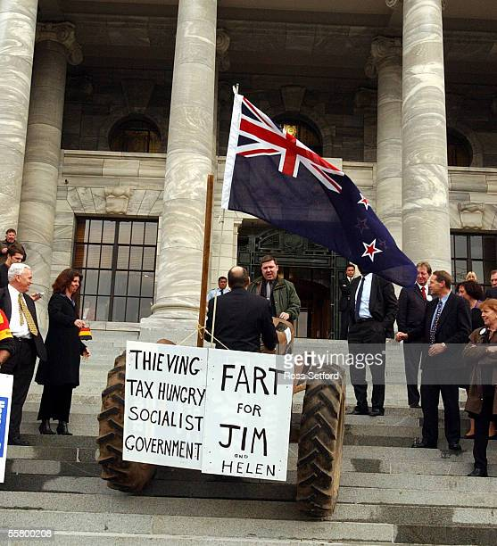 Security stops National MP Shane Ardern from driving a tractor up the steps as farmers protest outside Parliament Thursday against the fart tax which...