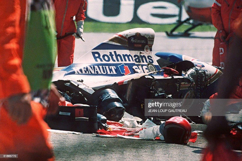 Security surrounds the crashed car of Ayrton Senna : News Photo