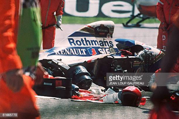 Security surrounds the crashed car of Ayrton Senna at the Imola track 01 May 1994 The triple Formula One champion died after crashing in the seventh...