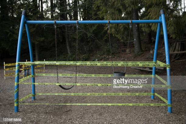 security tapes covers swings during covid19 lockdown - cordon tape stock pictures, royalty-free photos & images