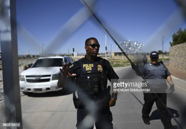 Security tell people to stop as they approach the border crossing fence at the Tornillo Port of Entry near El Paso, Texas, June 21, 2018 during a...