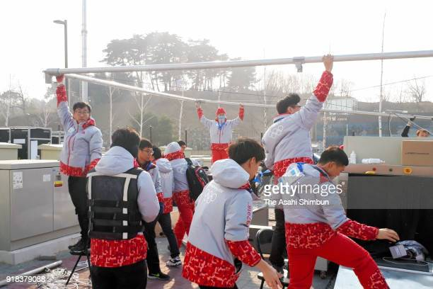 A security tent outside the Gangneung Ice Arena is pulled down due to strong wind during day four of the PyeongChang 2018 Winter Olympic Games on...