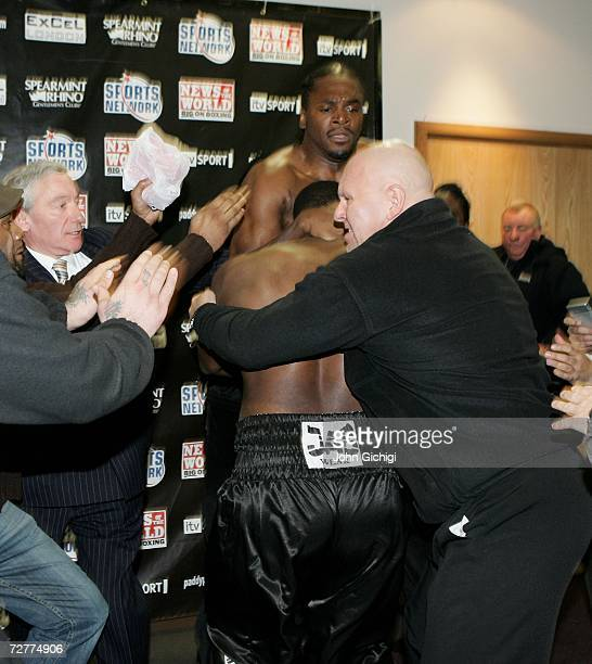 Security try to intervene between Danny Williams and Audley Harrison as they brawl during the weighin on December 8 2006 at the ExCel Centre in...