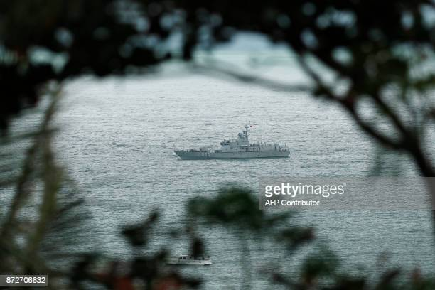 A security vessel is seen on the bay during the APEC Economic Leaders' Meeting part of the AsiaPacific Economic Cooperation leaders' summit in the...
