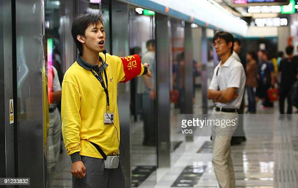 A security volunteer is on duty at a station of Subway Line 4 on September 28 2009 in Beijing China With a total length of 282 km Subway Line 4 runs...