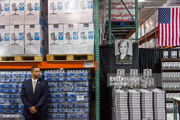 Security watches as former Secretary of State Hillary Clinton attends a signing her new book 'Hard Choices A Memoir' at Cosco in Arlington VA Clinton...