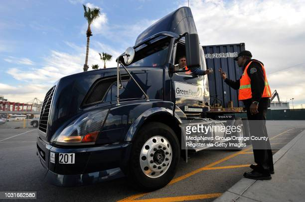 BEACH CA ILWU security worker RIchard Brown checks the identification of truck drivers as they enter Long Beach Container Terminal on Monday January...