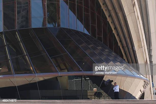 A security worker walks on the stairs of the Sydney Opera House after it was evacuated on December 15 2014 in Sydney Australia Major landmarks in...