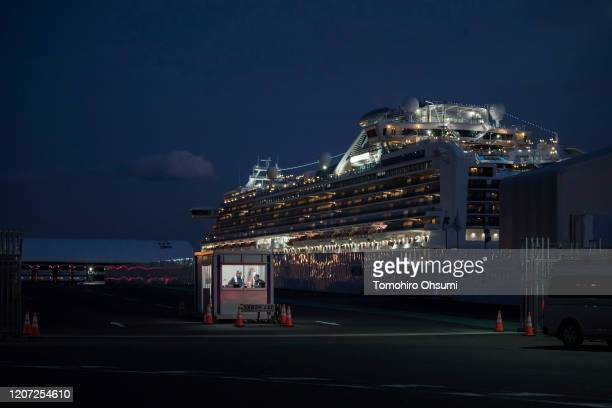 Security workers are seen at a gate to the cruise ship terminal where the quarantined Diamond Princess cruise ship is docked at the Daikoku Pier on...