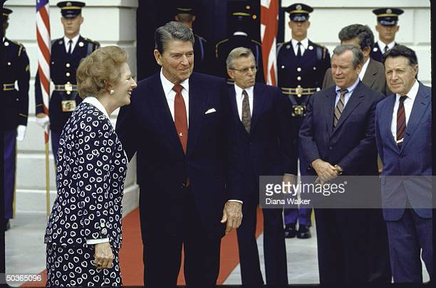 US Secy of Defense Caspar W Weinberger White House Chief of Staff Howard H Baker Jr and security adviser Frank C Carlucci watching as US Pres Ronald...
