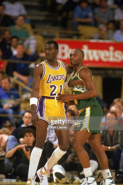 Sedale Threatt of the Seattle Supersonics and Michael Cooper of the Los Angeles Lakers battle for position during a game in the 19891990 NBA season...