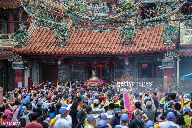 A sedan chair carrying a statue of the goddess Mazu is carried out of a temple on day 2 of the nine day Mazu pilgrimage on April 14 2018 in Dadu...