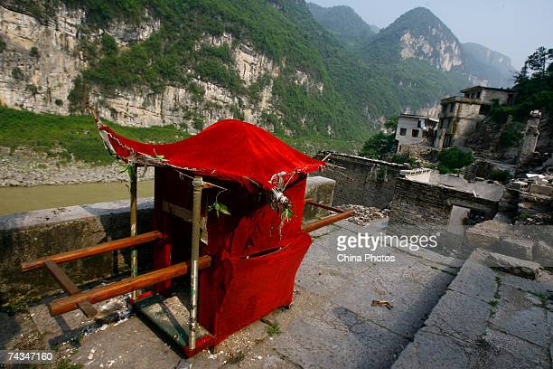A sedan chair rests in front of old houses in Gongtan Township May 27 2007 on the outskirts of Youyang County of Chongqing Municipality China Over...