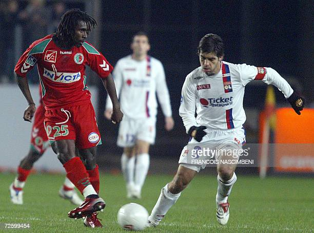 Lyon's midfielder Juninho from Brazil vies with Sedan's frenchSenegalese midfielder Aliou Cisse during their French L1 football match Sedan vs Lyon...
