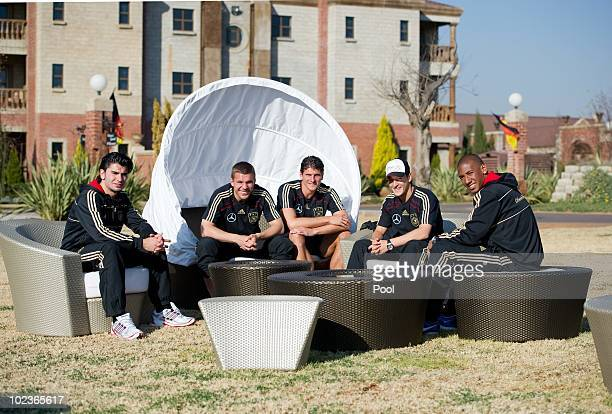 Sedar Tasci Lukas Podolski Mario Gomez Mesut Oezil and Jerome Boateng of the German National Team chat at the garden of the Velmore Grande Hotel on...