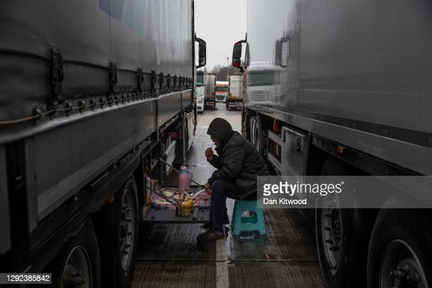 Sedat from Turkey eats a traditional breakfast out of his lorry as he waits in a service station on the M20 on December 21, 2020 in Dover, England....