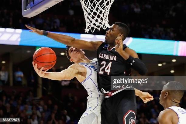 Sedee Keita of the South Carolina Gamecocks blocks a shot by Grayson Allen of the Duke Blue Devils in the first half during the second round of the...