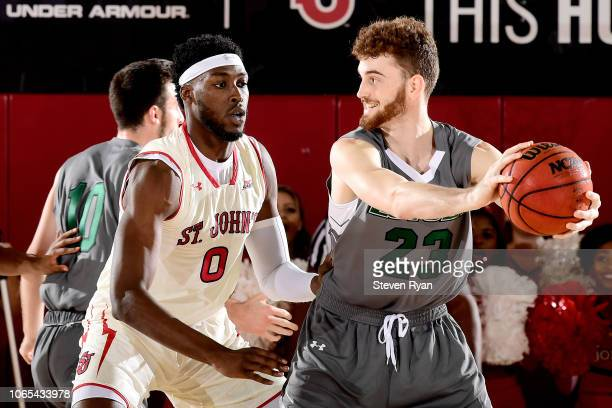 Sedee Keita of the St John's Red Storm defends Brent Holcombe of the LoyolaMaryland Greyhounds at Carnesecca Arena on November 6 2018 in New York City