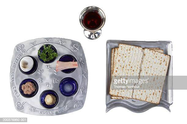 Seder plate, matzo and glass of wine, overhead view