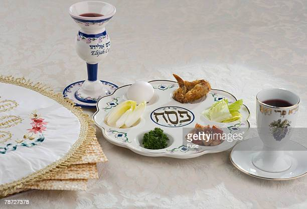 seder plate with matzoh bread and elijah cup - passover symbols stock pictures, royalty-free photos & images
