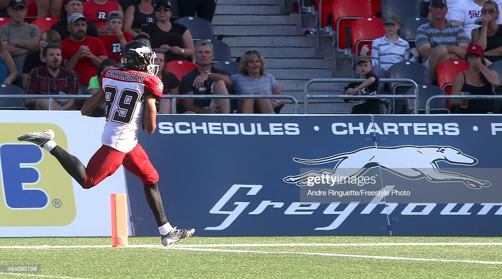 Sederrik Cunningham #89 of the Calgary Stampeders returns a punt for a touchdown against the Ottawa Redblacks during a CFL game at TD Place Stadium on August 24, 2014 in Ottawa, Ontario, Canada.