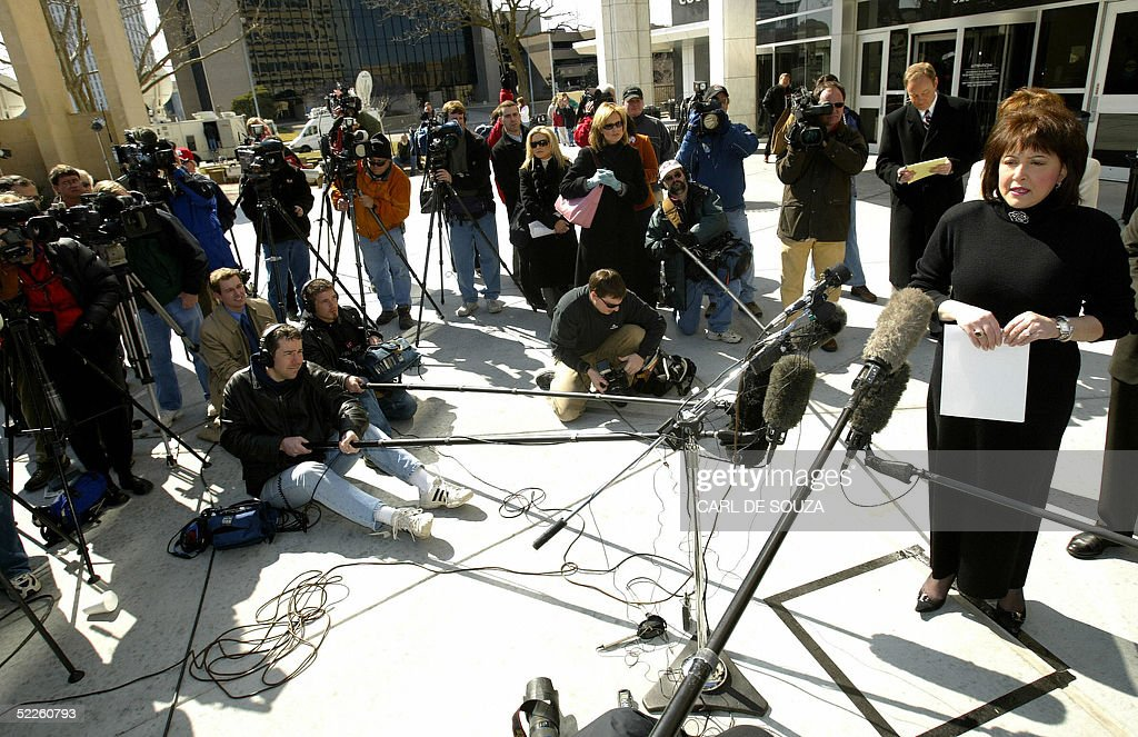 Sedgwick Court District Attorney Nola Foulston talks to the media outside the Sedgwick County courthouse after Dennis Rader's arraignment on 10 counts of first degree murder in Wichita, Kansas, 01 March 2005. Rader, a 59-year-old former security company worker accused of being the notorious 'BTK' serial killer was charged with 10 counts of murder in connection with a case which baffled Kansas police for three decades. Bail was put at 10 million dollars and his next court appearance set for March 15. Rader made his first court appearance via video link since he was arrested 25 February on suspicion of being the killer known as BTK, which stand for 'Bind, Torture, Kill' the grisly method employed by the murderer who terrorized the Wichita area for years. Authorities reopened their investigation in March 2004 after the killer, who had remained silent for decades, wrote to a local television station and sent a package containing the driver's license of a 25-year-old woman killed in December 1977. A Cub Scout leader, devout churchgoer and married father of two, Rader was a respected member of the local community before his arrest.