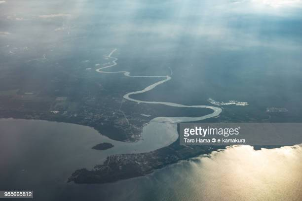 Sedili Besar in Johor in Malaysia sunset time aerial view from airplane