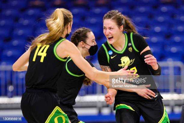 Sedona Prince of the Oregon Ducks celebrates with Lydia Giomi after defeating the Georgia Lady Bulldogs 57-50 in the second round game of the 2021...